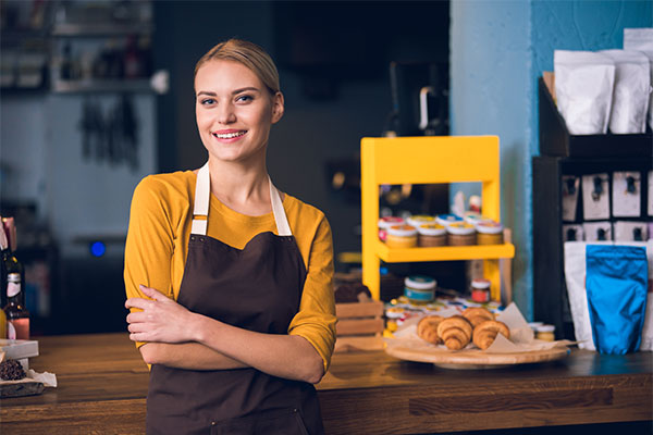 woman standing in bakery