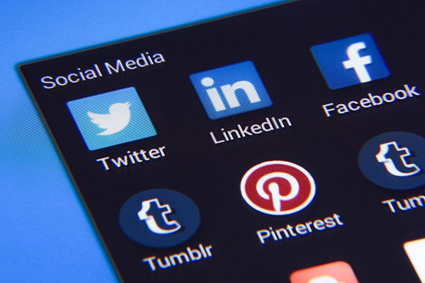 phone showing linkedin, facebook, twitter icons